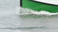 Green Boat Bow Splashing By Jetty Rocks Stock Footage