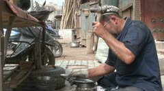 Making traditional artefacts, using a hammer, Kashgar, China Stock Footage