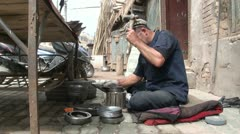 China craftsmanship workshop streets Kashgar Uyghur minority hammer work Stock Footage