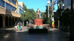 Chile Calama statue miner on red base and fountain 5 Stock Footage