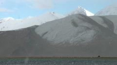 Snow at Karakul lake and mountains, China scenery - stock footage
