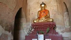 Gold Buddha inside pagoda in Bagan Stock Footage