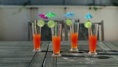 Cocktails with umbrella and lime on the table, dolly shot HD Stock Footage