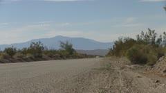 Stock Video Footage of Car on Quiet California Desert Highway