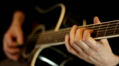 Male hands play on acoustic guitar - stock footage