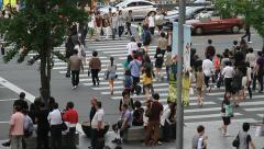 Crowds walking on pedestrian crossing in downtown city Stock Footage