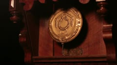 The Pendulum In The Old Wooden Clock - stock footage