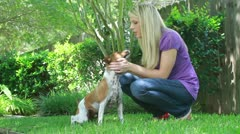 Woman in yard with dog dolly movement Stock Footage