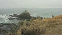 Chile people walking on a trail at Punta Lobos Stock Footage