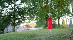 Young cute boy running and jumping on rope swing (low angle) Stock Footage