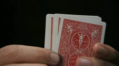 Playing Cards - looking at a hand of cards in poker Stock Footage