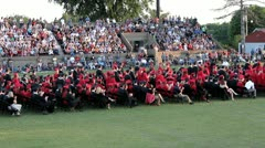 Large group of graduates sitting down simultaneously - stock footage