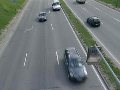 Closeup cars go highway Stock Footage