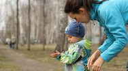 Young mother helps the child to clean their hands and hugs him Stock Footage