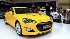 Yellow Hyundai Genesis at yearly automotive-show SIA 2012 in Kiev, Ukraine Stock Footage
