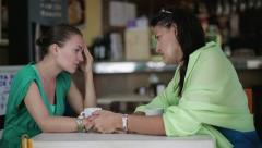 Young woman comforting her friend in cafe, steadicam shot HD - stock footage