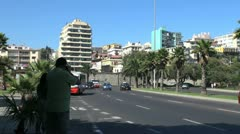 Chile Vina del Mar red and silver buses go by Stock Footage