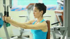 Beautiful girl involved in sports in the gym 2 Stock Footage