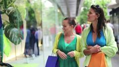 Happy friends with shopping bags walking in the city, steadicam shot HD Stock Footage