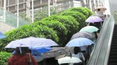 HONG KONG-UMBRELLAS-RAIN 1 - stock footage