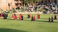 Graduates entering high school field for graduation ceremony Stock Footage