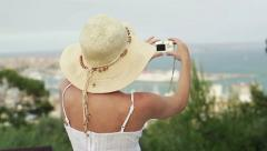 Woman in summer hat taking photo of beautiful landscape HD Stock Footage