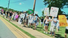 Gay protest of local preacher 5 27 12 drive by - stock footage