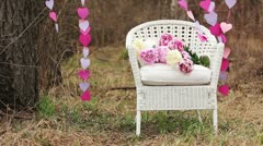 Decorations: White Chair and a garland of paper hearts Stock Footage