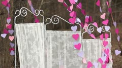 Decorations: White screen and a garland of paper hearts Stock Footage