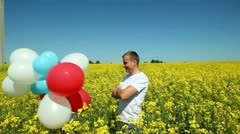 Happy couple with balls Stock Footage