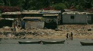Stock Video Footage of Shacks by the river bank in Mumbai suburb.