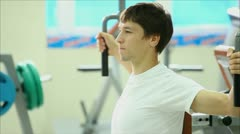 young guy in the gym for sports 7 - stock footage