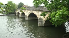 Arched Stone Bridge Over River Thames in Henley Stock Footage