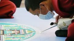 Tibetan monk making sand mandala. Stock Footage