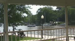 View of Boat Passing from Charming Gazebo Stock Footage