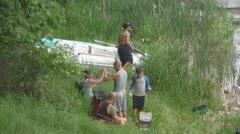 Relaxed Hispanic Family, Fishing on Shore Stock Footage