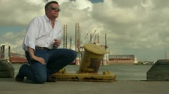 Man waiting on a pier dolly movement Stock Footage