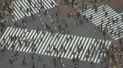 Aerial view Shibuya pedestrian crossing crowded zebra people jam day Tokyo Japan - stock footage