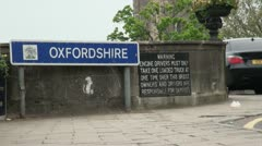 Oxfordshire County Sign By Bridge Stock Footage