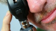 Stock Video Footage of Physician Uses Ophthalmoscope