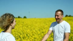Happy couple on rape field Stock Footage