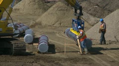 Pipeline construction, pipe tractor zoom out Stock Footage