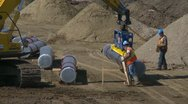 Stock Video Footage of pipeline construction, pipe tractor zoom out