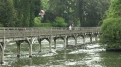 Walking Wooden Footpath Bridge Henley on Thames Stock Footage