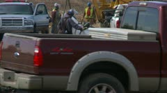 Pipeline construction, welding crew trucks pulls out, tight frame Stock Footage
