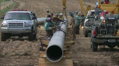 Stock Video Footage of pipeline construction, welding crew tight shot, #1