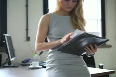 Businesswoman reading documents in the office, steadicam shot Stock Footage