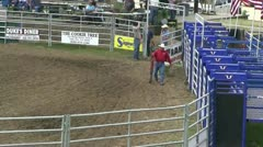 Rodeo, cowboy preparing for ride Stock Footage