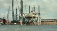 Stock Video Footage of pan oil platform following barge