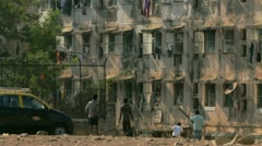 Children outside apartment building in Mumbai - stock footage